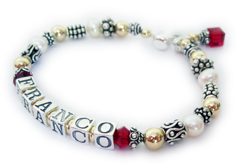 DBL-PS2  Enter: FRANCO/Jul  This is a 1-string Pearl, Bali and Gold Mother Bracelet: Franco with July or Ruby Swarovski Birthstone Crystals before and after his name. They also added a Ruby Swarovski Crystal Birthstone Charm.