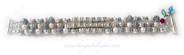 DBL-PS1-3string with 3 names Enter: MURPHY MARCELLA MAX  This is a 3-string Pearl and Sterling Silver Name Bracelet with 3 kids' names. They also added 3 birthstone crystal dangles: Ruby, Peridot and Aquamarine Swarovski Crystal Birthstone Charms. It is shown on a 3-string slide clasp which I recommend with 3 or more strings. However, you may choose any clasp your like.