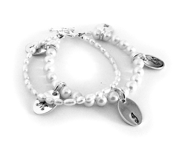 The bracelet is 2 strings of Fresh Water off-white pearls (6mm semi-round and 4mm rice shaped). YOU add the number of Oval Initial Charms as you want. Each sterling silver charm is hand-stamped with a initial.