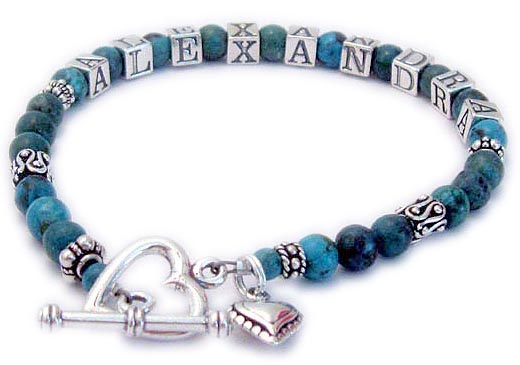 This is a 1-strong Turquoise Name Bracelet for Moms and Grandmas with ALEXANDRA. They added a Beaded Heart charm and upgraded from one of my beautiful free clasps to a Heart Toggle clasp.