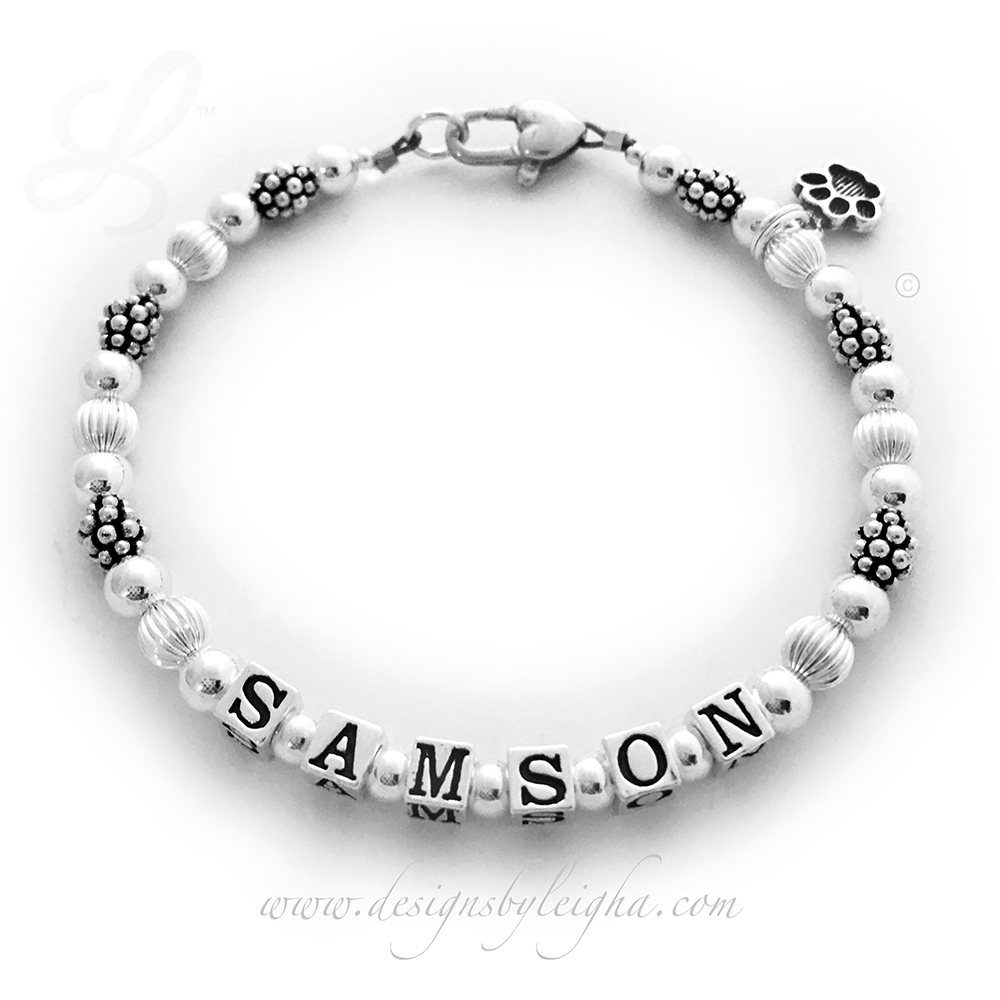 This Paw Print Bracelet is perfect for animal lovers everywhere! It is shown with Samson on the bracelet and a Paw Print Charm is included. They added a Heart Lobster Claw Clasp. It comes with a simple beautiful simple Lobster Claw Clasp. Everything is .925 sterling silver. You may have up to 9 letters for free. You may put as many names as will fit on a 1-string or get a 2-string bracelet.