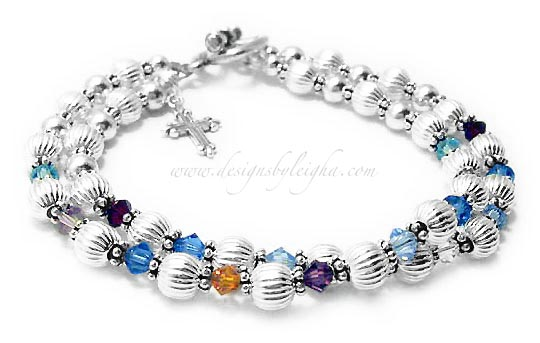 This is a two string bracelet with 9 Birthstone on the first string and 8 crystals on the second string.  1st String Crystals; March, June, September, December, February, November, September, June and March Birthstone Crystals. 2nd String Crystals: January, September, March, April, April, December, September and January.