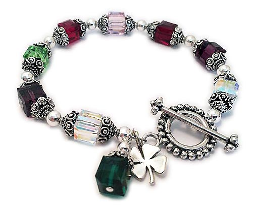 This bracelet is shown with 8 - 8mm square Swarovski crystals for her 8 grandkids. Shown: April or diamond, February or Amethyst, January or Garnet, June or Pearl, July or Ruby, August or Peridot, Amethyst or February and another April or Diamond. When ordering please abbreviate e.g. Apr Feb Jan Jun Jul Aug Feb Apr.  They also added 3 additional things... they upgraded to a Beaded Toggle clasp and added a 4-Leaf Clover charm and a Birthstone Crystal Dangle for Grandma's Birthmonth of May / Emerald.