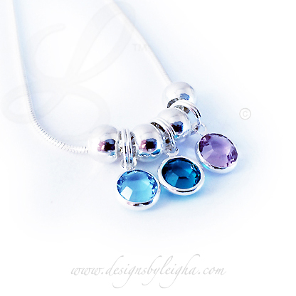 Swarovski Crystal Channel Birthstone Necklace shown with 3 birthstone charms - March, December and June and includes spacer beads