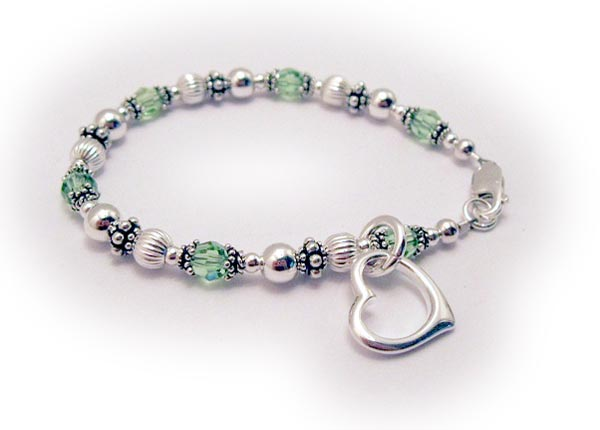 This bracelet is shown with an optional Open Heart Charm and Peridot or August Birthstone Crystals