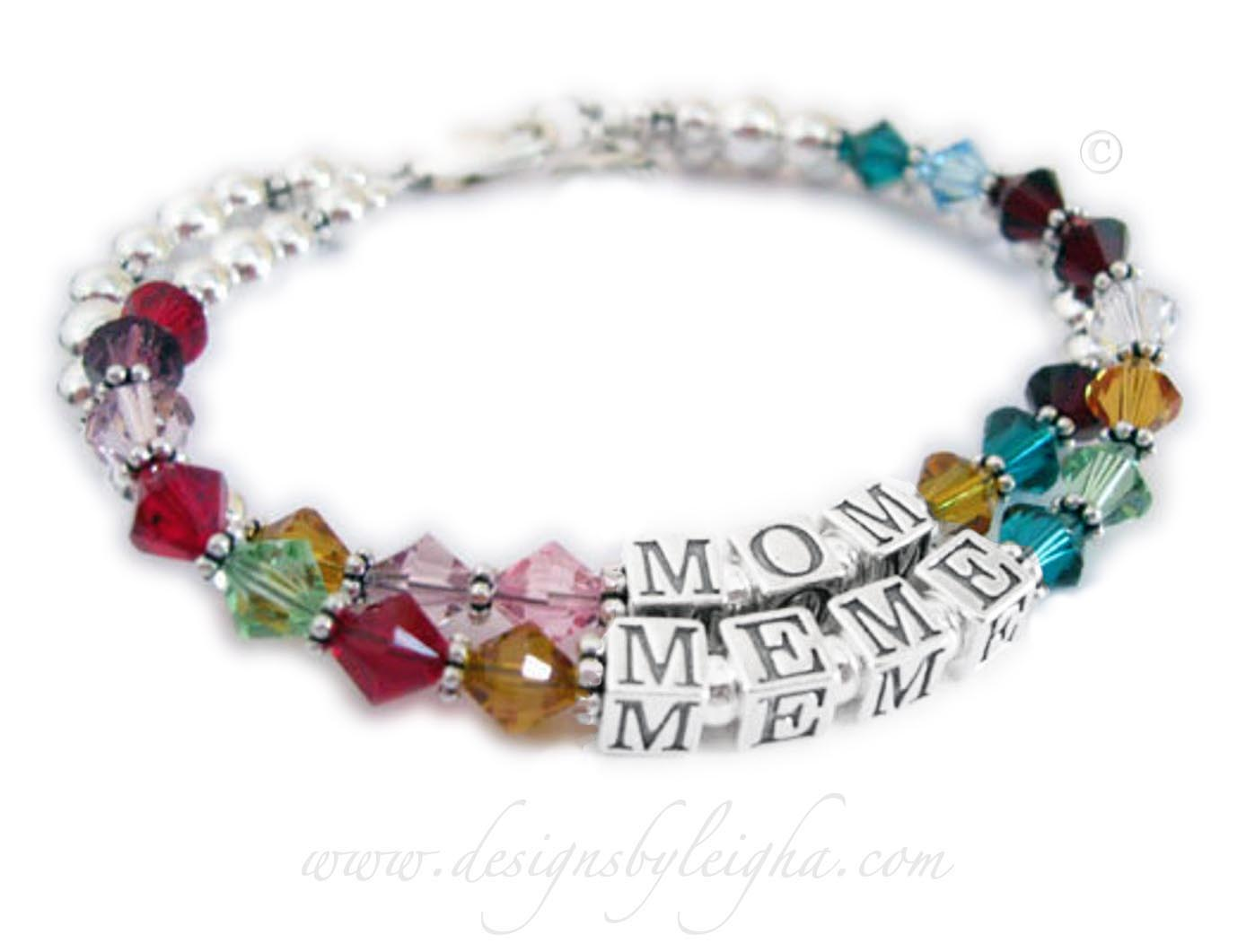 Mom and Meme Birthstone BraceletThis is a 2 string bracelet with a lobster claw clasp. The first string says MOM with her kids' birthstones. The second string says MEME with her grandkids' birthstones. They added a Beaded Heart charm to their order.