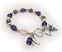 Purple In Memory Bracelet with an IN MEMORY bead, Angle Charm, Ribbon Charm and heart toggle clasp