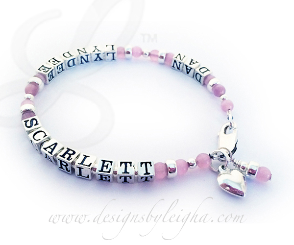 This Cat's Eye Name bracelet is a 1-string bracelet shown with 3 names: Dan, Lyndee and Scarlett. They picked one of my beautiful free lobster claw clasps and added 3 things to their order; 8 extra sterling silver block letters (9 are free PER string), a sterling silver Puffed Heart Charm and a pink Birthstone Dangle.