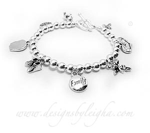 This FAMILY Charm bracelet is shown with a Teddy Bead carhm, Filigree Love charm, Boy Profile Charm, Baby Boy Booties Charm, FAMILY charm, Angel with Wings charm, Heart within a Heart charm and a Fancy Cross charm.