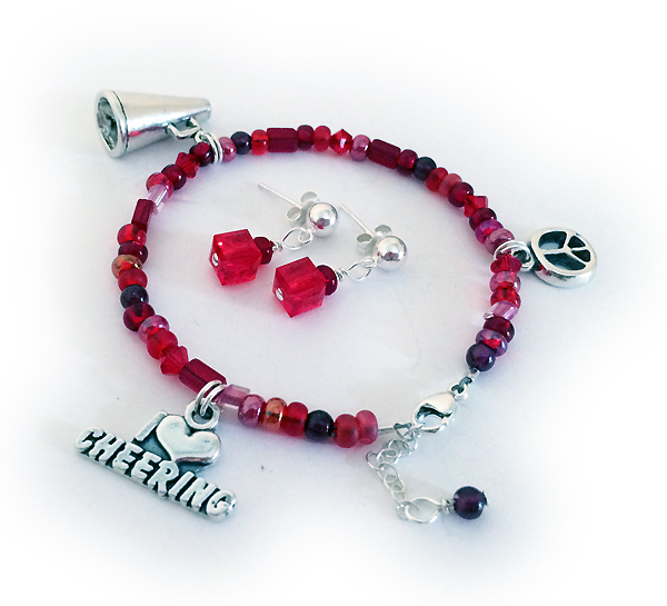Cheer Charm Bracelet Includes 3 charms and an extention clasp. PEACE SIGN charm, I HEART CHEERING charm and MEGAPHONE charm