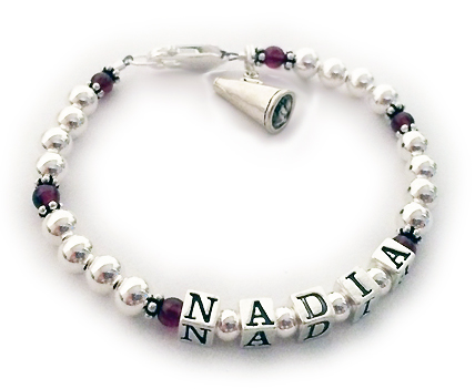 DBL-Sport1-1stringThis Soccer Mom Bracelet shows MADIA with a Soccer Ball Charm and January or Garnet Gemstones and one of my free lobster claw clasps.
