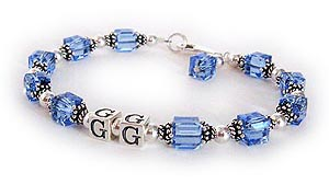 GG Bracelet - GG is shown with December or Blue Topaz Swarovski crystals. They picked one of my free lobster claw clasps and added a December or Blue Topaz Birthstone Crystal Dangle.