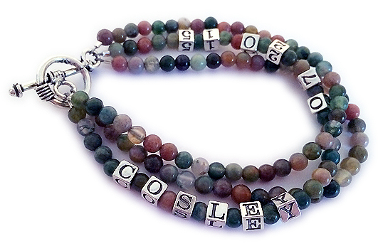 This bracelet is made with 4mm round Fancy Jasper beads and other colorful gemstones. It has 4.5mm block letters and a sterling silver clasp. You choose the number of strings. This bracelet is shown with 3 strings. Cosley is shown with Cosley's birthday.