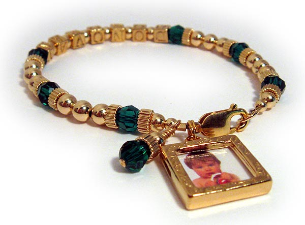 Gold Mothers bracelet with gold block letters and emerald crystals