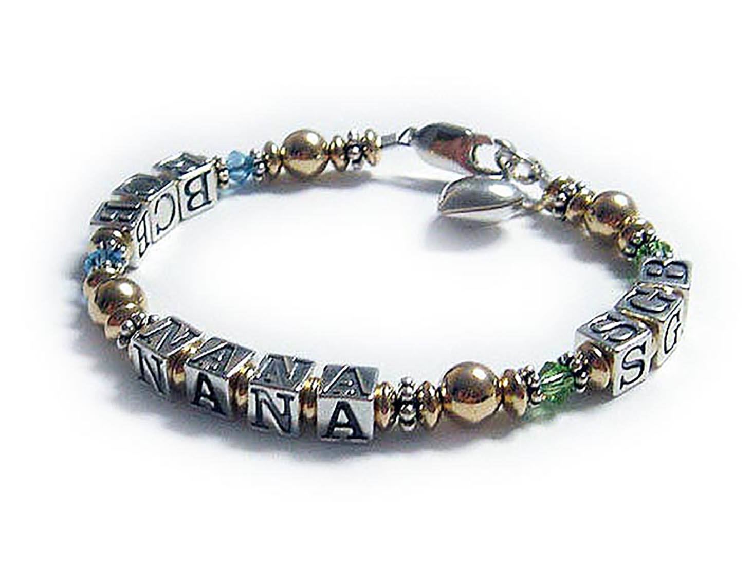 "DBL-MB5-1string bracelet with 3 ""names"". Enter: BCB/Mar - NANA - SGB/Aug This is a one string bracelet. NANA has 2 grandkids so we put one on each side of NANA and accented their intiials with their birthstone crystals. BCB is March or Aquamarine Swarovski crystals and SGB is August or Peridot Swarovski crystals. The picked the free lobster clasp and added a sterling silver Puffed Heart Charm."
