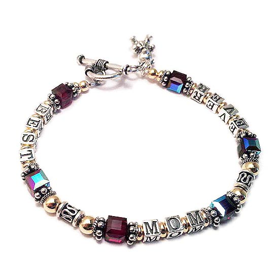 DBL-Message Bracelet 11-1string with message ENTER: BEST MOM EVER/Jan This Gold & Bali Message Bracelet is a 1 string bracelet with a message on one string: BEST MOM EVER. They added a Teddy Bear charm and a Beaded Heart charm.