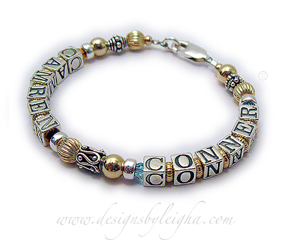 DBL-G6-1 string  This is a 1- bracelet with 2 names. Enter: CAMREN/Nov CONNER/Mar This is a 1-string Gold Grandma Name Bracelet with Camren and Connor and November or Golden Topaz Swarovski crystals before and after CAMREN and March or Aquamarine Swarovski crystals before and after CONNER.
