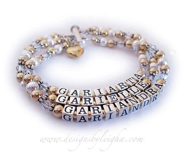 This Gold Mothers Birthstone Bracelet with Swarovski Crystals is a 3-string bracelet with 3 names: GARIARTA (April or Diamond Crystals) - GARIELLE (April or Diamond Crystals) - GARIANDRA (April or Diamond Crystals). They choose a 3-string slide clasp and added a Gold Puffed Heart Charm to their order.