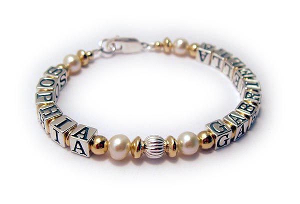 DBL-G9 - 1 string bracelet  Enter: SOPHIA GABRIELLA Two names are shown on this 1-string Gold, Pearl and Bali Mother Bracelet. The kept the beautiful simple free lobster claw clasp.