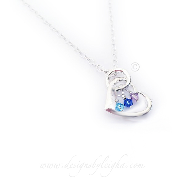 Materials: .925 sterling silver, Swarovski Crystal Charms
