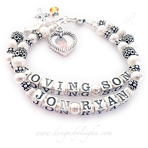 DBL-PS1-2-string bracelet ENTER: LOVING SON - JON RYAN This is a 2-string Pearl, Bali and Sterling Silver Name Bracelet with LOVING SON on one string and JON RYAN on the second string. There are a lot of different ways we can do an IN LOVING MEMORY BRACELET. They added an IN MEMORY bead, a Fancy Cross charm, A November Birthstone Crystal Dangle Charm and a Heart Picture Frame charm - Special order - no extra charge.