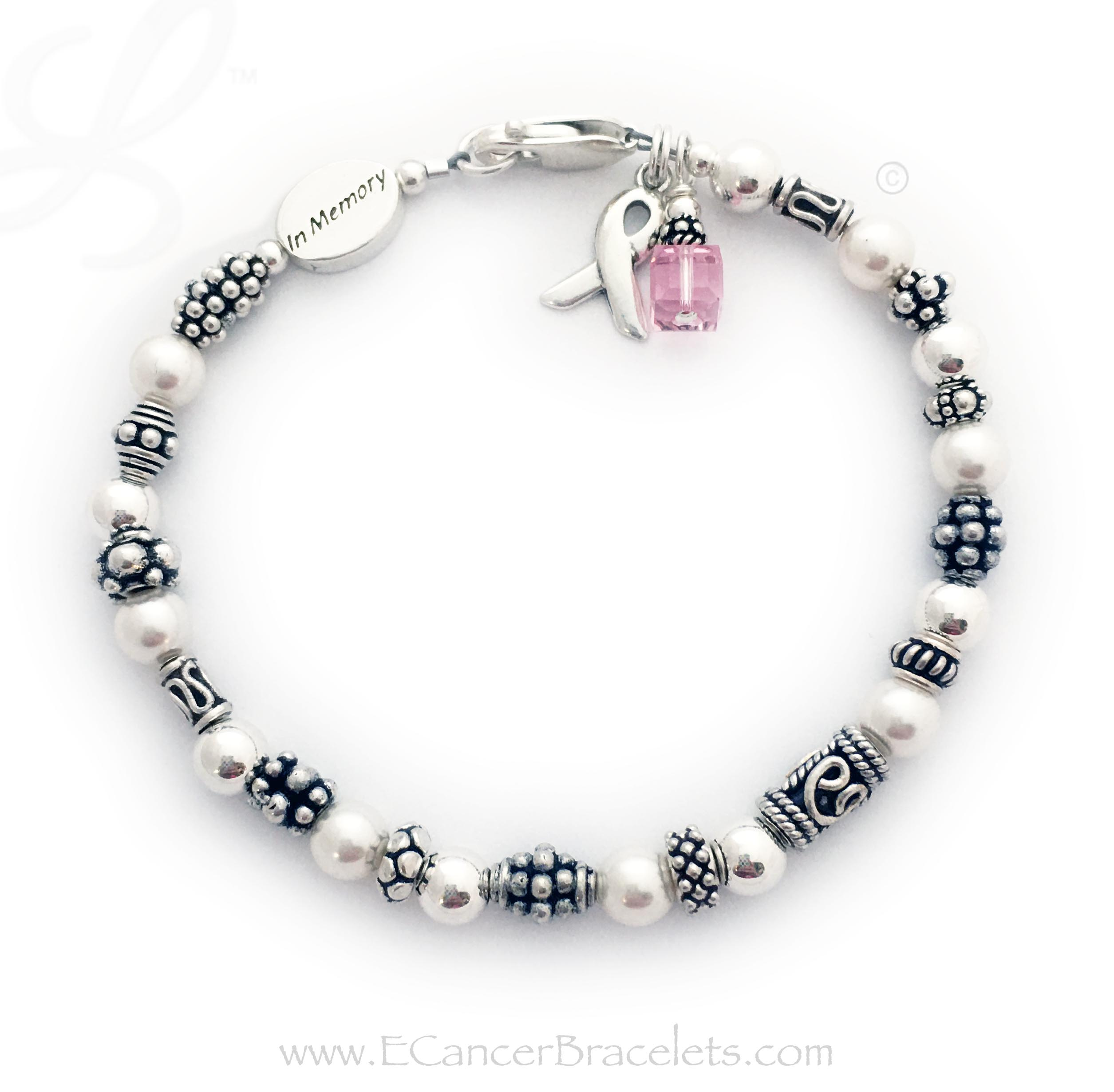 This is a .925 sterling silver and Pearl In Memory Ribbon Bracelet. You choose the color of the crystal dangle. I have 18 cancer color options. They picked pink for Breast Cancer. This bracelet comes with a Ribbon Charm and a Crystal Dangle. You may add additional charms to this design.