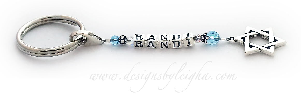 This key chain is shown with 1 Name, Randi, March or Blue Topaz Swarovski crystals and an upgraded Star of David charm.
