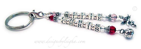 This Name key chain is shown with ALLIE and 2 June birthstone Swarovski Crystals (4mm round and 6mm round) and a upgraded ANGEL with WINGS charm. The second strand (which would be added separately) shown CHRIS and 2 July birthstone Swarovski crystals and an upgraded SOCCER BALL charm.