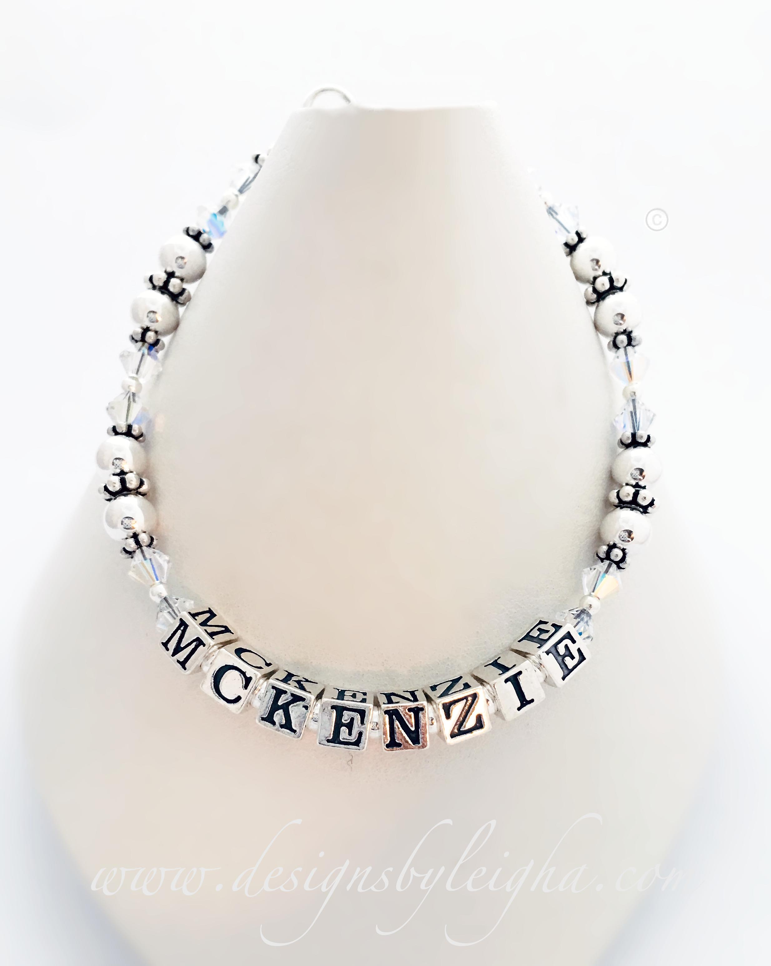 Enter: MCKENZIE / April This Mommy Mom Birthstone Bracelet is a 1-string bracelet shown McKenzie and April Birthstones (clear / diamond). Shown with a lobster claw clasp.
