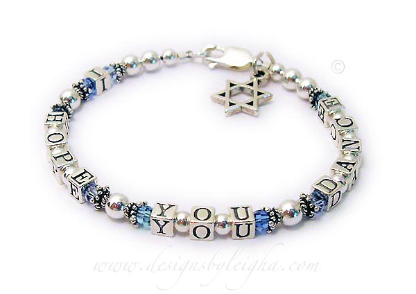 I Hope You Dance Message Bracelet shown with 3 different colors of Blues by Swarovski. They choose a lobster claw clasp and added a Star of David charm to their cart.
