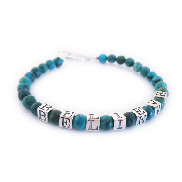 This Turquoise Beaded Bracelet says BELIEVE. It is a 1-string bracelet shown with a toggle clasp. You may add any message to any of my designs!