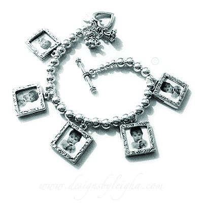 This picture frame charm bracelet is shown with 5 picture frame charms and 3 add-ons: They upgraded to a Heart Toggle clasp and added 2 charms: a Teddy Bear Charm and an Angel Charm