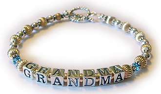 DBL-GMA5-1 This Gold Grandma Birthstone bracelett is shown with a Round Toggle clasp and March or Aquamarine Birthstones before and after Grandma. Enter: Mar GRANDMA Mar
