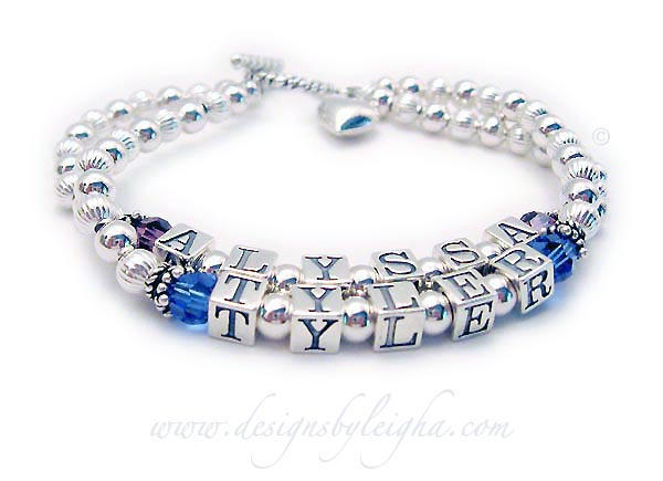 DBL-SS1-2	String Bracelet  Alyssa (February) and Tyler (September) Birthstone Mothers Bracelet with a Twisted Toggle clasp and they added a Puffed Heart charm to their order.  2 names / 2 strings