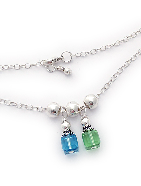 7 Birthstones on a Charm Necklace - March, February, August, December, March, December Febraury