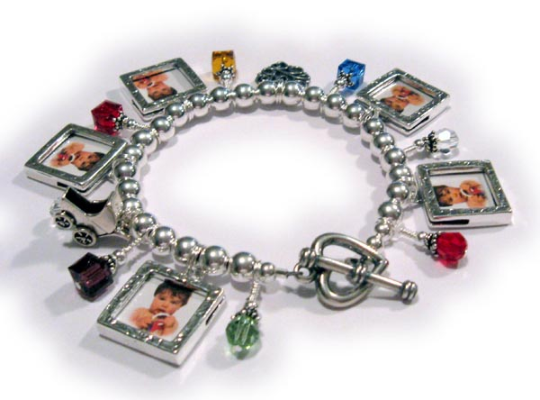 Love Charm Bracelet Shown with a love charm. baby carriage charm, 7  birthstone crystal