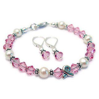 Simple Pink Breast Cancer Ribbon Charm Bracelet shown with matching pink crystal earrings. CBB-R48